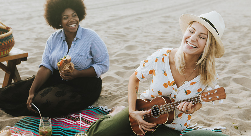 Female friends singing together at a beach picnic. What are the best kinds of weed in Toronto and Scarborough?