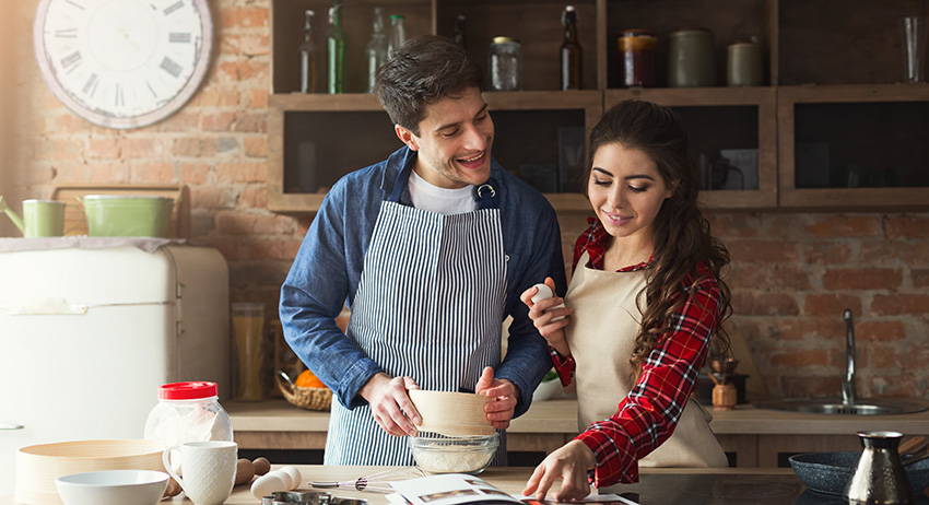 woman and man looking at recipe in kitchen. by weed online east toronto.
