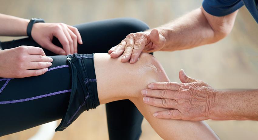 woman rubbing CBD hemp cream on her knee for pain relief