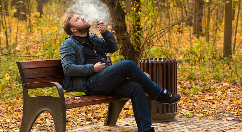 Man taking a break to smoke weed in scarborough at a local park near Toronto.